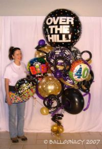 Over the HillOver the Hill and over 9 feet tall!  This one is a sure show stopper!  Over the hill bouquets and balloon arrangements, 40th birthday, 50th birthday, black balloons, balloon art. Click To Zoom