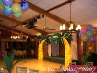Palm TreesHaving a Luau?  Feel like Hawaii?  These Palm Trees will enhance the mood at your next tropical event!  Summer, palm tree arches, stage props. Click To Zoom